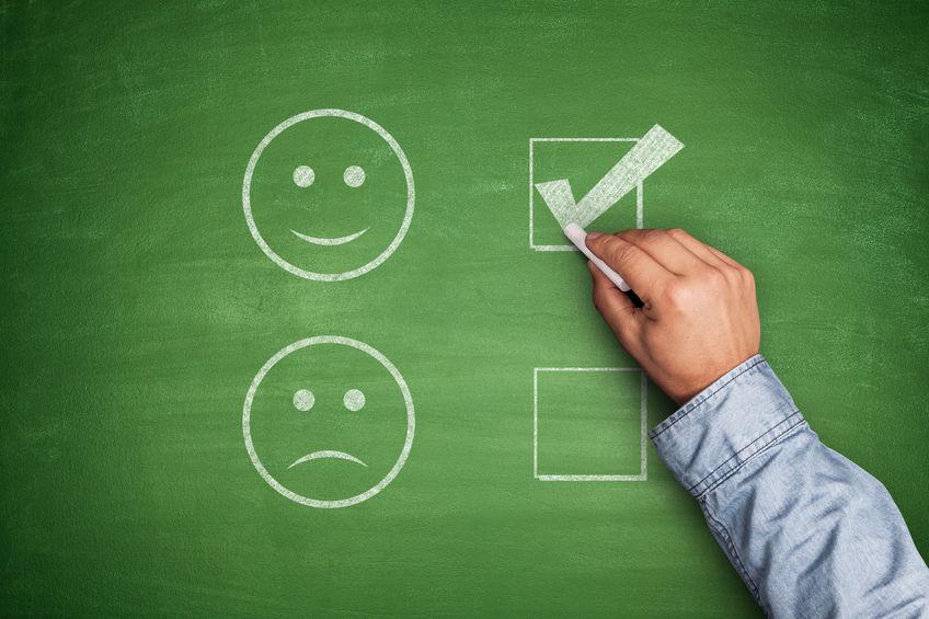 33905558 - positive feedback on green blackboard with hand